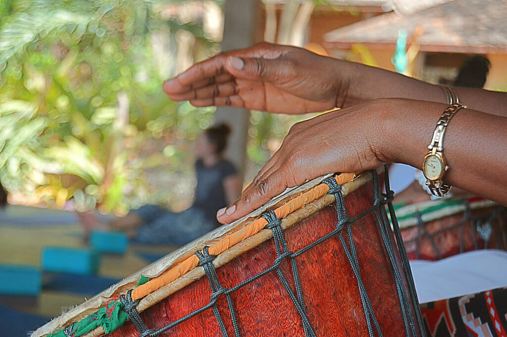 caregiver drumming on a drum